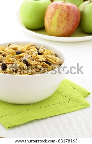 delicious and healthy granola or muesli with fresh organic apples and pears , with lots of dry fruits, nuts and grains. - stock photo
