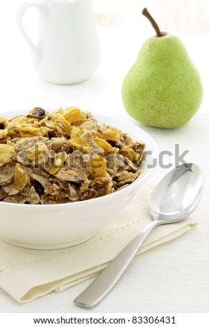 delicious and healthy granola or muesli with fresh organic pear, with lots of dry fruits, nuts and grains. - stock photo