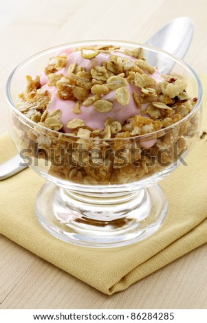 delicious and healthy granola or muesli, with lots of dry fruits, nuts and grains. - stock photo