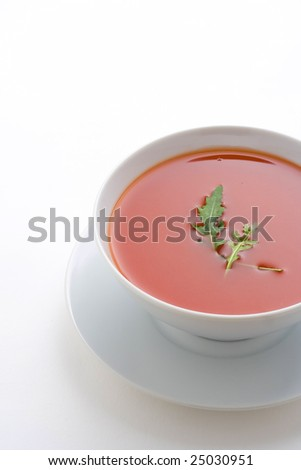 delicious and healthy homemade tomato soup and vegetables isolated - stock photo