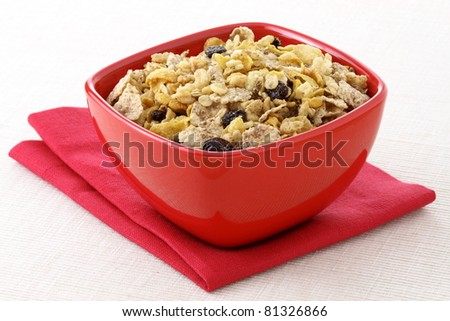 delicious and healthy wholegrain muesli breakfast, with lots of dry fruits, nuts and grains - stock photo