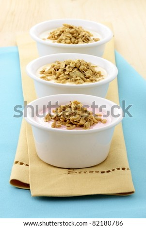 delicious and healthy yogurt and granola, with lots of dry fruits, nuts and grains - stock photo