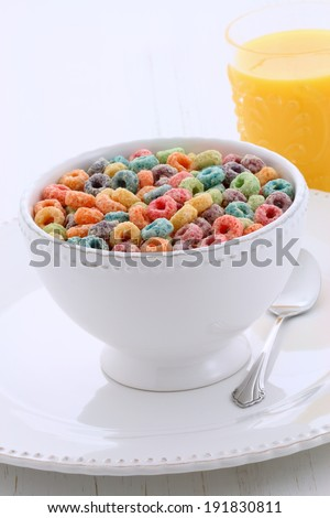 delicious and nutritious, cereal loops, with healthy organic orange juice - stock photo