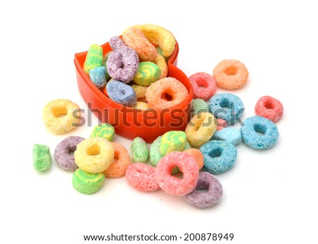 Delicious and nutritious fruit cereal loops flavorful in bowl on white background, healthy and funny addition to kids breakfast  - stock photo