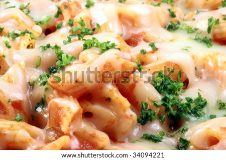 Delicious and perfect made to perfection penne pasta with parmesan cheese and exquisite  fresh organic tomatoes sauce vegans or vegetarians will love it - stock photo