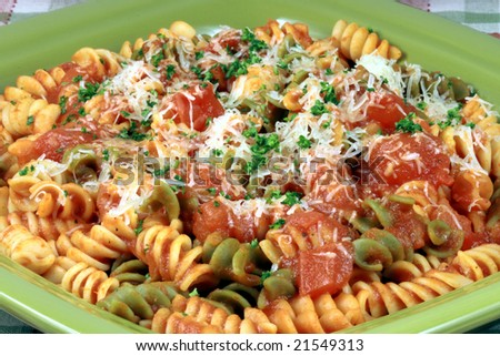 Delicious and perfect made to perfection rainbow rotelli pasta with sauce