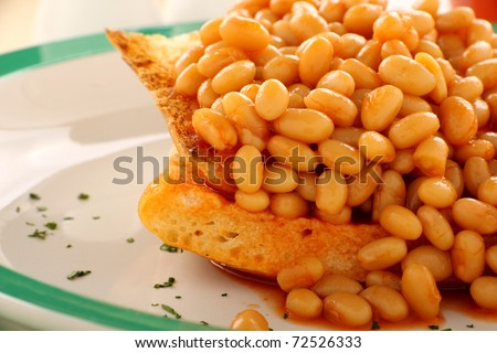 Delicious and simple old fashioned baked beans stack on toast. - stock photo