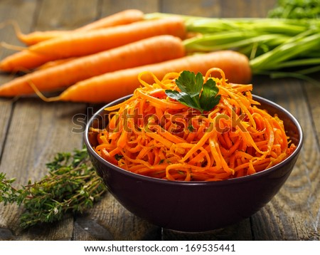 Delicious and spicy carrot spaghetti with ginger, garlic, chilli and lemon - stock photo
