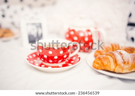 Delicious and tasty fresh coffee or tea cup and croissants as snack - stock photo