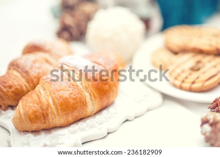Delicious and tasty fresh croissants as breakfast meal - stock photo