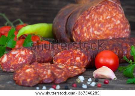 Delicious and tasty meat dishes. Smoked sausage and salami. Italian appetizers. - stock photo