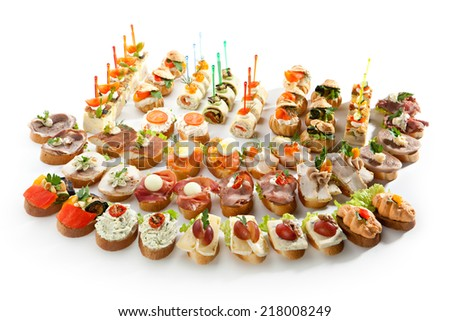 Delicious Appetizer Canapes Isolated over White - stock photo