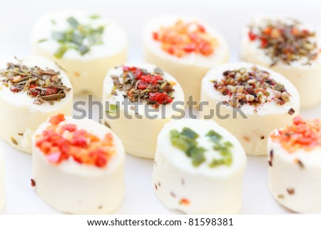 Delicious appetizer - cream cheese with different minced herbs and vegetables
