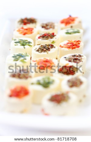 Delicious appetizer - cream cheese with different minced herbs and vegetables - stock photo