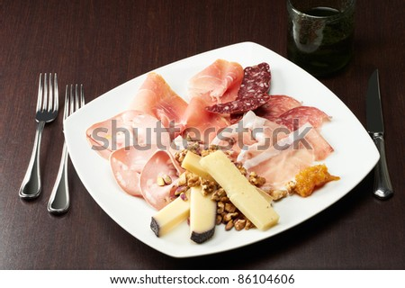 delicious appetizer with ham, cheese and pepperoni - stock photo