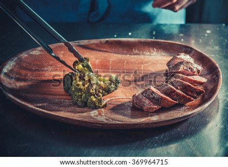 Delicious appetizer with herbs on wooden table close up - stock photo