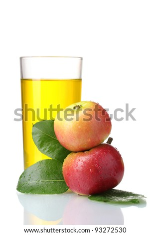 Delicious apple juice in glass and apples isolated on white - stock photo