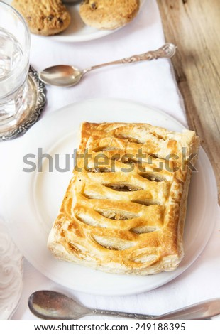 Delicious Apple Pastry Strudel, Tasty Breakfast Dessert and Coffee Cups - stock photo