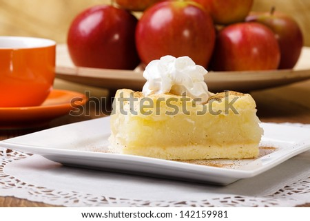 Delicious apple pie with whipped cream, the proposal application. - stock photo