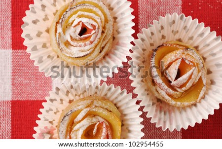 Delicious apple pies dessert on red cloth - stock photo