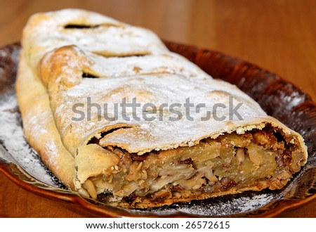 Delicious apple strudel on a plate. - stock photo