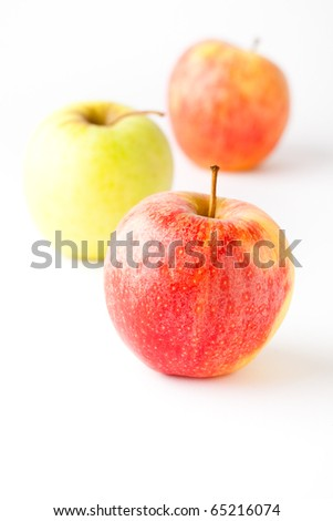 Delicious apples on a white background. Small DOF.