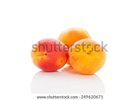 Delicious apricots isolated on white background. Healthy fruit eating.  - stock photo