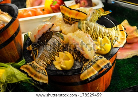delicious arrangement of seafood - lobsters, shrimp, fresh fish. This photo focuses on succulent fresh lobster tail.