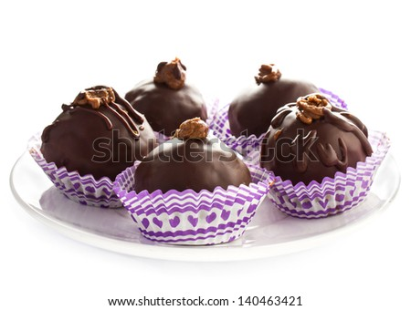 Delicious assorted dark tasty chocolate truffle candies on a white plate, isolated - stock photo