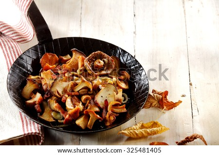 Delicious assortment of fried autumn mushrooms including king oyster or pleurotus mushrooms, ready to serve as a healthy vegetarian snack or accompaniment to a meal - stock photo