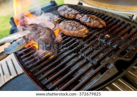 Delicious Australia Day BBQ. Boneless leg pieces of Australian marinated lamb  cooked on grill - stock photo