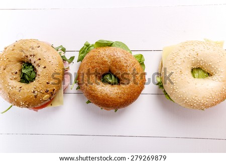 Delicious bagel sandwich on the table - stock photo