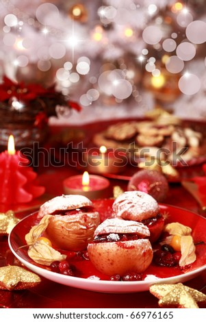 Delicious baked apple with cranberry stuffing for Christmas - stock photo