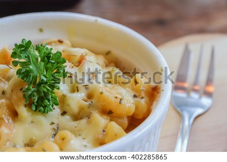 Delicious Baked Macaroni with Golden Cheese and Parsley on the Top - stock photo