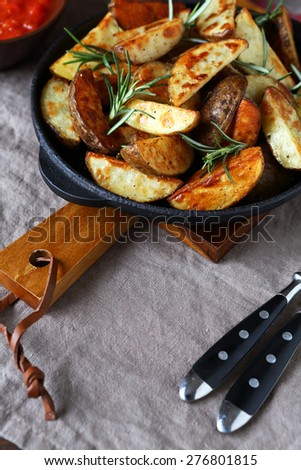 Delicious baked potato slices, tasty food - stock photo