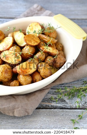 Delicious baked potato  with thyme, delicious food - stock photo