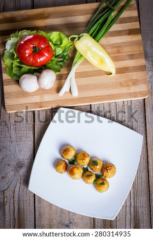Delicious baked potatoes on a plate with tasty vegetables - stock photo