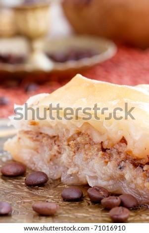Delicious baklava dessert in oriental golden setting. Shallow depth of field. - stock photo