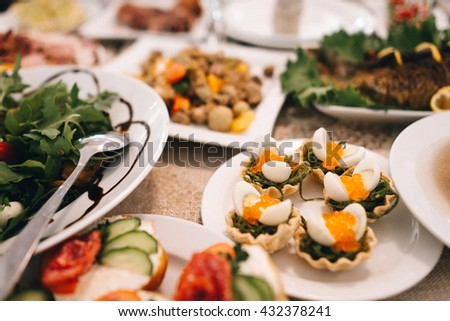 delicious baskets with salad, quail eggs and caviar