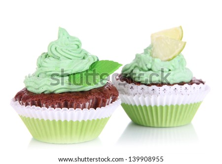 Delicious beautiful cupcakes isolated on white