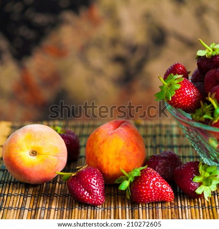 delicious beautiful  strawberries and peach background - stock photo