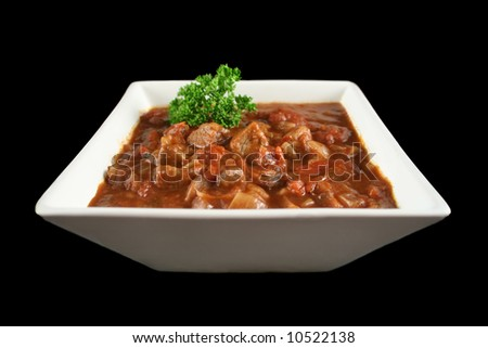 Delicious beef and red wine casserole ready to serve. - stock photo