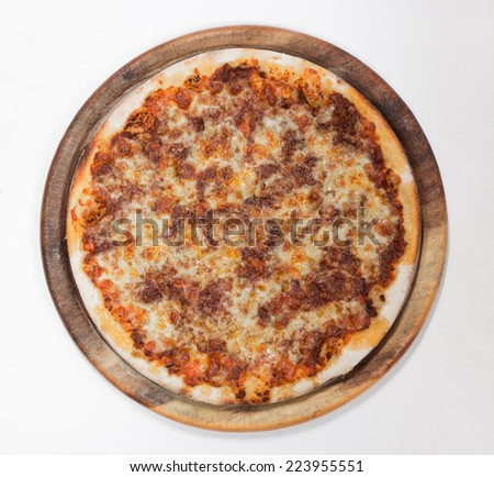 Delicious beef sauce pizza top view on white background - stock photo