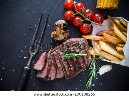 Delicious beef steak on stone background, close-up - stock photo