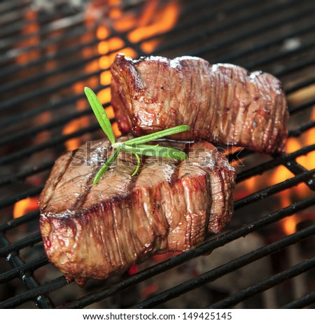 Delicious beef steakes on grill - stock photo