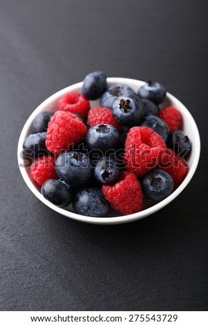 Delicious berry in a plate, food - stock photo
