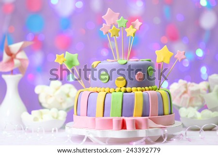 Delicious birthday cake on shiny pink background - stock photo