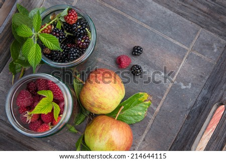 Delicious blackberries and blueberries in a glass - stock photo