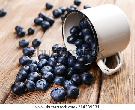 Delicious blueberries in cup on table close-up - stock photo