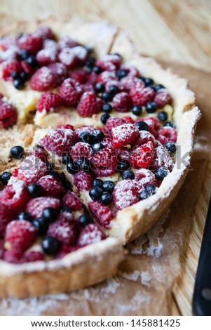 delicious blueberry pie with raspberries, food close up - stock photo